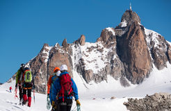The Aiguille du Midi peak; in foreground a defocused group of mo Royalty Free Stock Photography