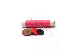Aiguille et bouton rose Photo libre de droits