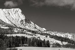 Aiguille Peak covered in snow, Hautes Alpes, Alps, France. Aiguille Peak near Gleize and Bayard Pass covered by snow in winter. Black & White. Champsaur, Hautes Royalty Free Stock Photo
