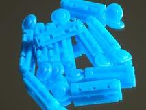 Aiguilles brillantes bleues sur le verre Photographie stock libre de droits