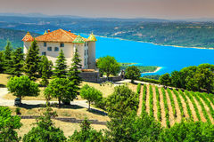 Aiguines castle with St Croix lake in background, Provence, France, Europe stock photos
