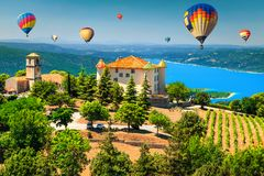 Aiguines castle and St Croix lake with hot air balloons stock images