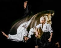 Aikido bodokas man and woman isolated black background stock photography