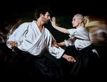 Aikido bodokas man and woman isolated black background stock images