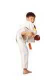 Aikido boy. A young boy aikido fighter in white kimono Royalty Free Stock Photos