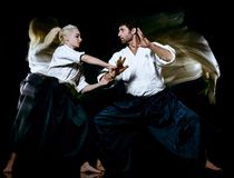 Aikido budokas man and woman isolated black background stock photos