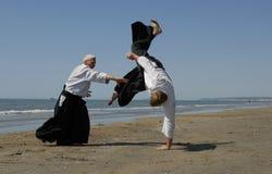 Aikido en la playa Imagen de archivo libre de regalías