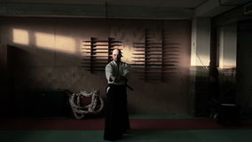Aikido fighter with sword at sports hall stock video footage