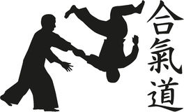Aikido fighters with signs. Aikido fighters with chinese caligraphy signs Royalty Free Stock Photography
