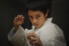 Aikido kid. A child practice martial arts in defensive posture royalty free stock photos