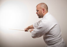Aikido man with bokken royalty free stock image