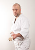 Aikido man with a stick Royalty Free Stock Photo