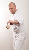 Aikido man with a stick. Man with a stick on light background royalty free stock images