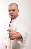 Aikido man with a stick. Man with a stick on light background stock images