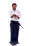 Aikido master pointing thw sword Stock Photos