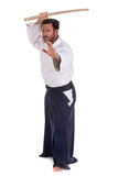 Aikido master with wood sword Royalty Free Stock Photography