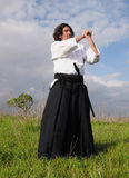 Aikido practice. Man practising martial arts outdoors with a sword and with typical Japanese clothes Stock Photography