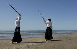 Aikido sur la plage Photos libres de droits