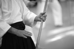 Aikido. Testing of fighting techniques with a sword in aikido Stock Photos