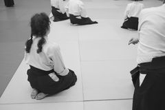 Aikido training participants sit on a mat. In special clothing of hakama aikido Stock Photography