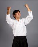 Aikido winner. Happy man in aikido uniform Stock Photo