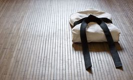 Aikidogi on bamboo mat Royalty Free Stock Photo