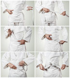 Aikidoka belt tying step by step pictures Royalty Free Stock Photography