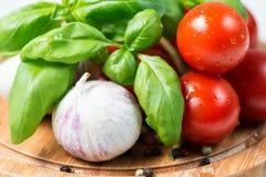 Ail de tomate de basilic et poivre de maïs Photos stock