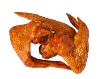 Aile de poulet gonflée délicieuse sur le blanc image libre de droits