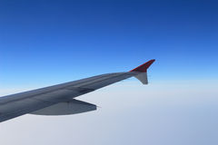Ailerons and flaps tucked flat in airplane wing at cruise speed Stock Photos