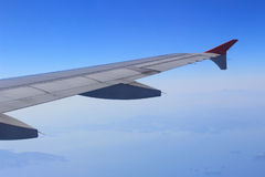 Ailerons and flaps tucked flat in airplane wing at cruise speed. And altitude Stock Photography