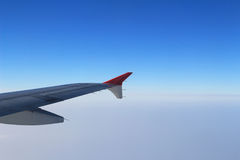 Ailerons and flaps tucked flat in airplane wing at cruise speed. And altitude Royalty Free Stock Photography