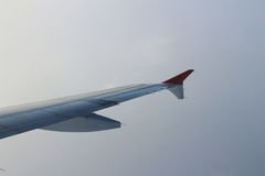 Ailerons and flaps tucked flat in airplane wing at cruise speed. And altitude Stock Photo
