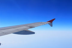 Ailerons and flaps tucked flat in airplane wing at cruise speed. And altitude Stock Photos