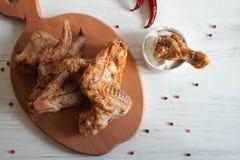 Ailes de Chiken avec la crème aigre photo libre de droits