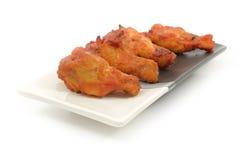 Ailes de poulet épicées Photographie stock