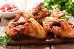 Ailes de poulet cuites au four photo stock