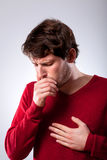 Ailing man suffering from pneumonia. Ailing young man suffering from pneumonia, vertical stock photos