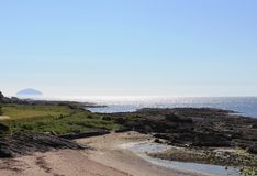 Ailsa Craig seen across Firth of Clyde from Maidens Royalty Free Stock Image