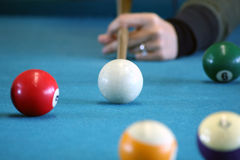 The aim. Playing pool. All the balls lined up for the next play Stock Photography