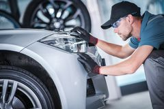 Aim and Adjust Headlights. Aim and Adjust Car Headlights. Caucasian Worker in Front of the LED Vehicle Front Lamp Looking For Issues. Safety on the Road royalty free stock photos