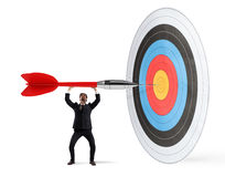 Aim the center. Businessman puts a big dart in the target center Royalty Free Stock Image