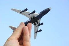 Aim High. Hand holding toy plane, as if launching it into the air Stock Photos