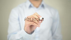 Aim high and Create Action, Man writing on transparent screen stock footage