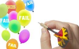 Aim success balloon. Man holds dart to aim success balloon Stock Photo