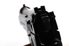 Aimed gun. On white background Royalty Free Stock Image