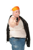 Aimed pistol. Fat guy with leather jacket and aimed pistol Royalty Free Stock Images