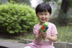 Aimed shot. A child is playing her water pistol Stock Photos
