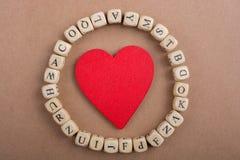 Aimez l'icône et marquez avec des lettres les cubes de faire du bois Images libres de droits