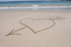 Aimez le coeur et le sable de flèche, Costa Rica Photographie stock
